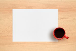 Sheet of paper and coffee cup