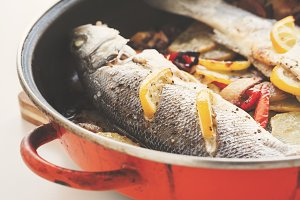 Cooked seabass in a pan