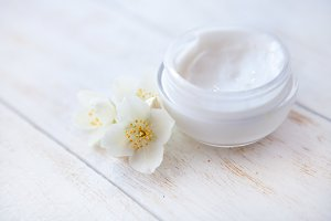 face cream with  jasmine blossom on