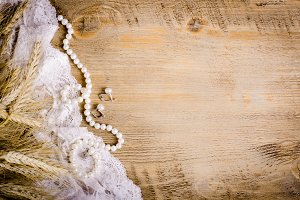 Lace, pearl jewerly, ears of corn