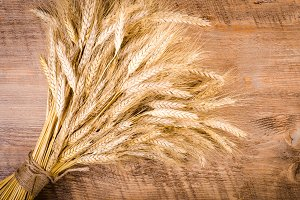 Ears of wheat on wooden