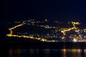 Night view of harbor and fortress