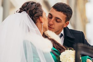 Morning wedding  kiss in  Prague