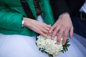 Closeup of hands of  bridal couple
