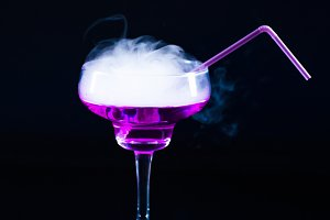 photo of a colored drink  with smoke