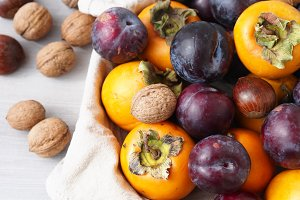 Persimmons and plums