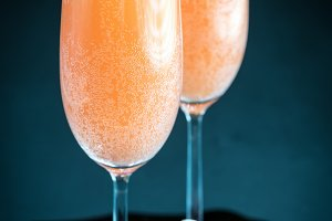 Two bellini cocktails with grape