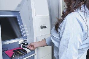 Girl using an ATM