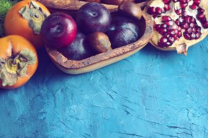 Colorful winter fruit on blue