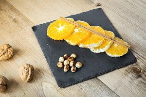 Orange slices with cinnamon and nuts