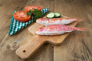 Fresh red mullet with tomatoes and p