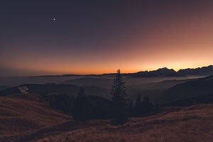 Sunset in the grassy hills