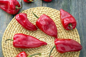 Peppers  over wooden background