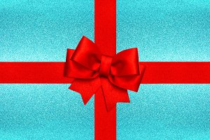 Red ribbon bow on blue background