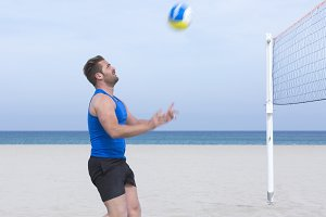 male player playing beach volley