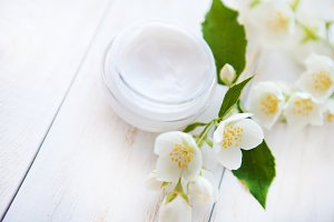 Pot of beauty cream with flower