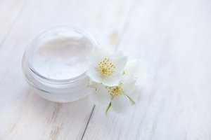 Pot of beauty cream with  jasmine