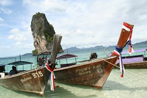 long-tail boats on a thailand beach