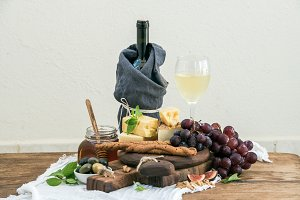 Glass of white wine and cheese board