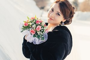 Beautiful bride with bouquet  posing