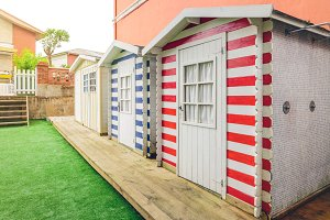 Beach striped huts in a home garden