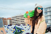 Young woman with penny skate