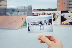 Hand holding instant photo in skate