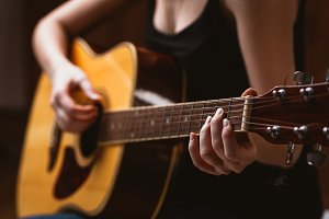 woman's hands playing   guitar