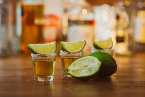 tequila , lime and salt on wooden  t