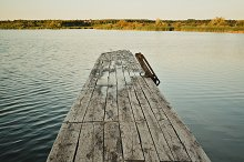 Wooden Pier in Cold Autumn Water