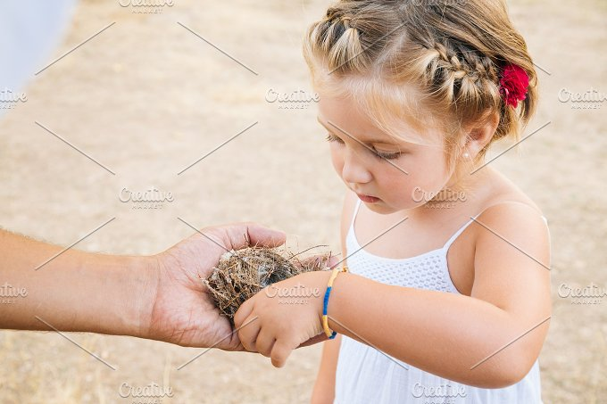 Holding nest.jpg - People