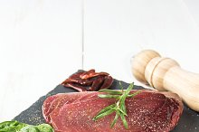 Raw tuna steak with peppers and herb