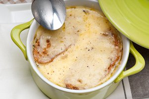 onions soup with melted cheese and toasts on top 08.jpg