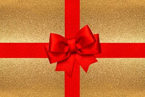 Red ribbon bow golden background