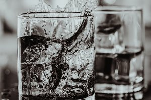 2 glasses of whiskey black and white
