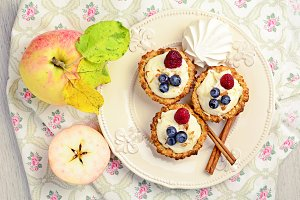 Tarts with cream and berries