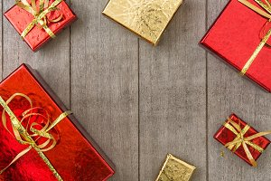 Red and gold gift boxes on wood
