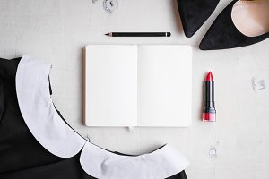 Blank notepad with feminine objects