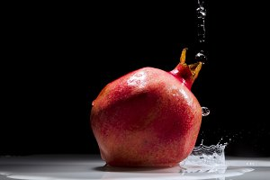 Pomegranate splashing water