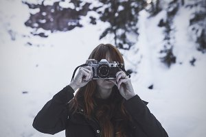 Woman in Snow with a Film Camera