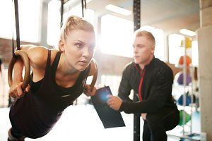 Woman with her personal trainer exer