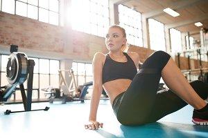 Young woman having break in fitness