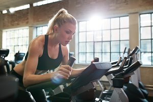 Woman working out on exercise bike a