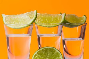 Tequila shot with a slice of lime