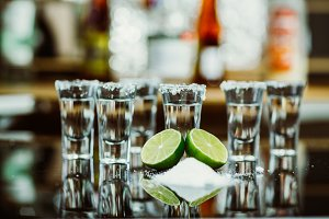 two shots of tequila with lime