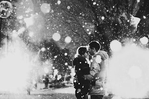 In love couple kissing in the snow