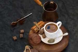 Black coffee with chocolate biscuits