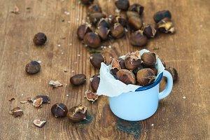 Roasted chestnuts in enamel mug