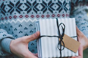 Hand holding Christmas gift
