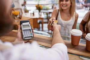 Customer paying at a cafe